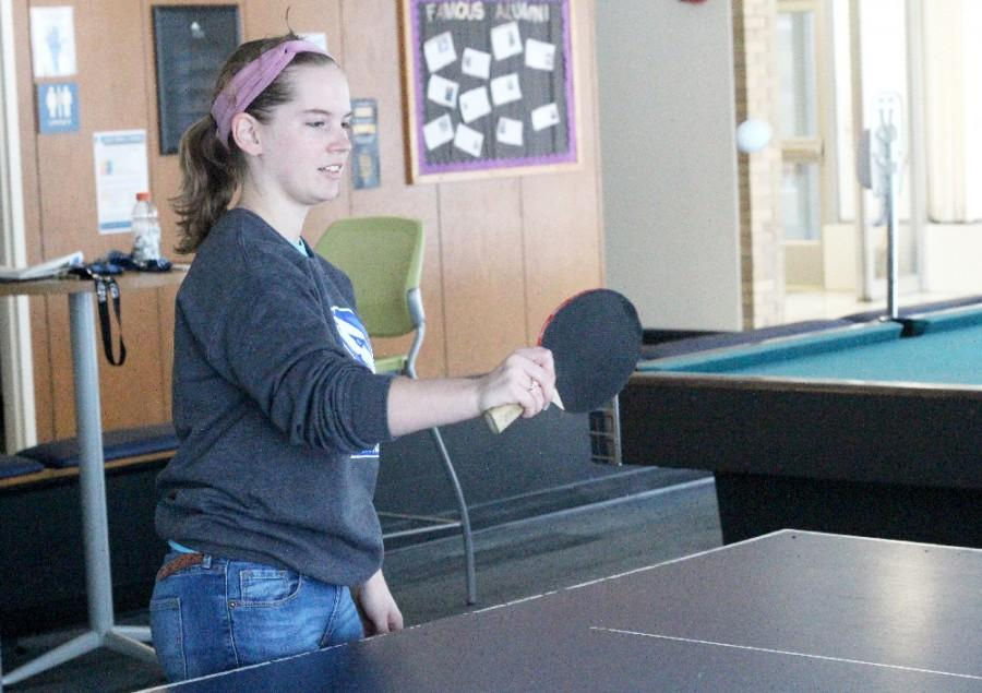 Ava Gillespie, a freshman history and English major, plays ping pong in the Thomas Hall lobby during the snow day Wednesday.
