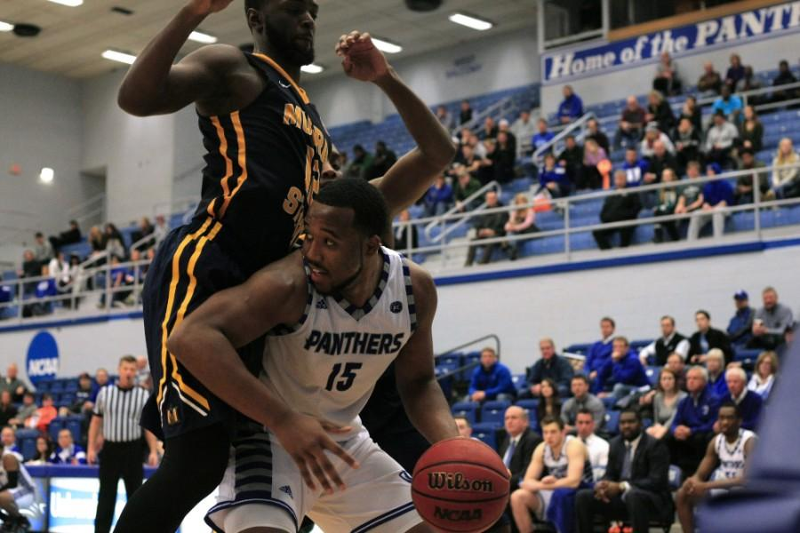Senior wing Trae Anderson looks around a Murray State player to try and pass the ball. Anderson led the team with 22 points in the Panther's 85-74 win Wednesday in Murray State.