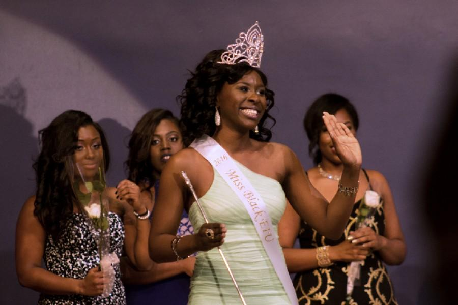 Julianne Adegoriolu, a junior kinesiology and sports studies major waves at the crowd after being crowned Miss Black EIU 2016 on Saturday in the Grand Ballroom of the Martin Luther King Jr. University Union.
