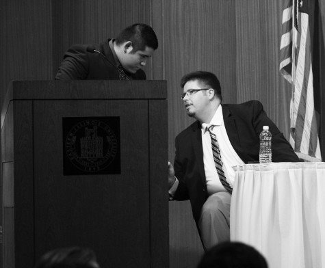 Jonathan Williams and Juan Nevarez, members of the College Deomcrats, deliberate during a debate between them and the College Republicans Tuesday night in the Grand Ballroom of the Martin Luther King Jr. University Union.