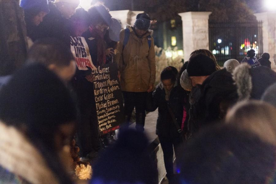 Students pray outside the gates at Old Main on Dec. 2, 2014.  The event, sponsored by the Performing Arts for Effective Civic Education student organization, was a solidarity march from Carman Hall to Old Main for the events in Ferguson, Missouri.