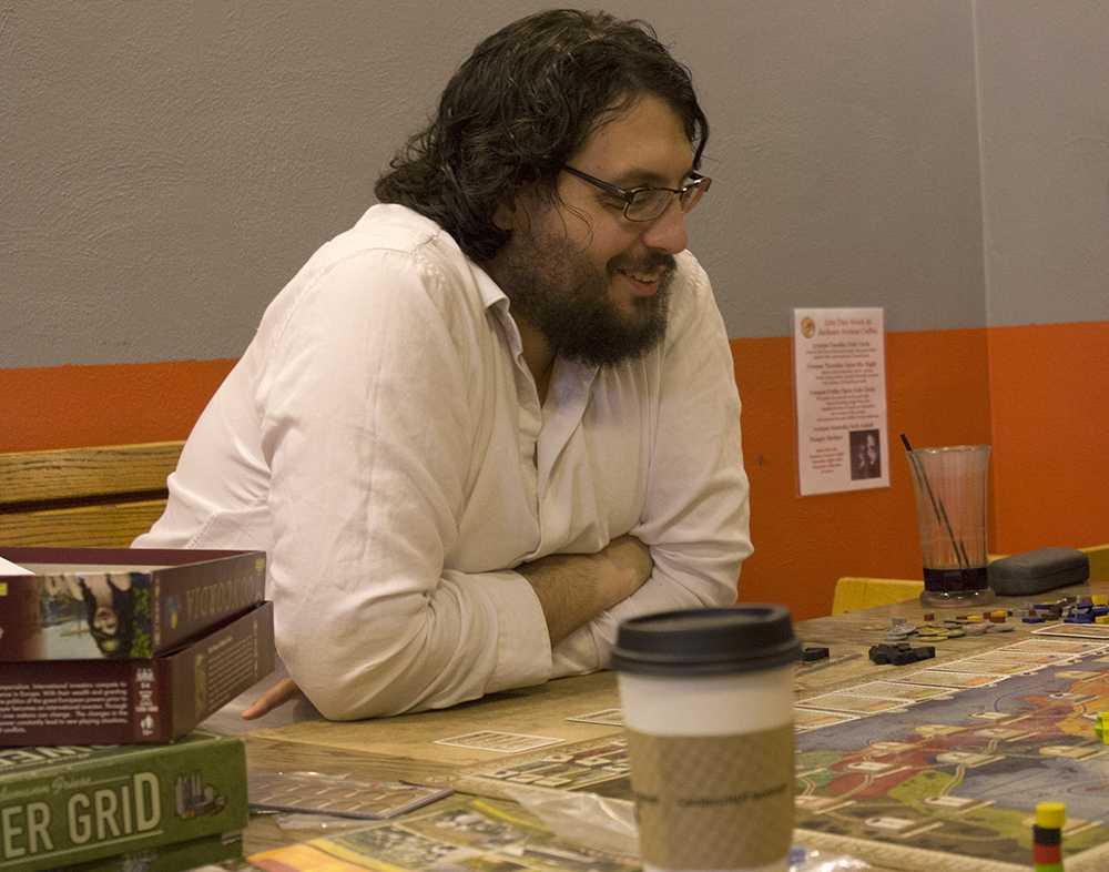 Community member Michael Rundles plays Concordia during the EIU Game Club meeting at Jackson Avenue Coffee Shop Tuesday.
