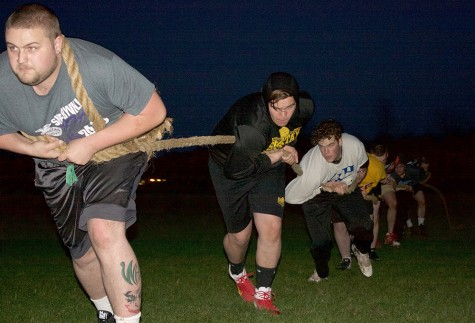 Members of Phi Kappa Theta practice for Tugs at the Sigma Kappa Field near Textbook Rental on Thursday.