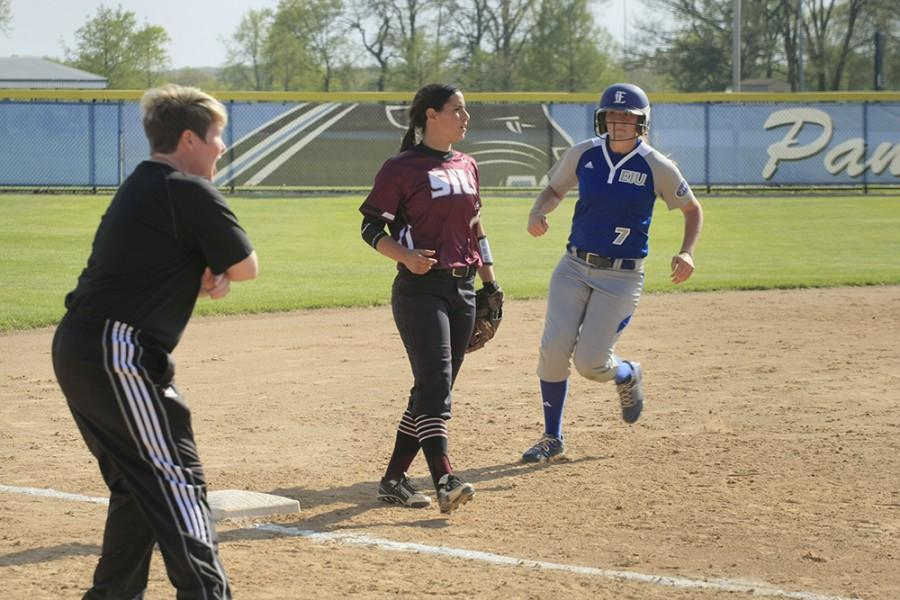Sophomore+utility+player+Tori+Johnson+watched+her+coach+as+she+rounded+third+to+see+if+she+should+run+home+during+the+game+against+Southern+Illinois-Carbondale+at+Williams+Field+on+April+29%2C+2015.