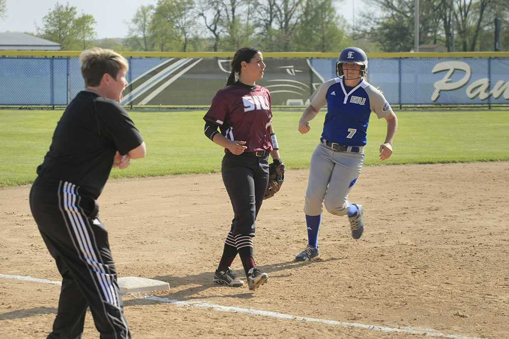Sophomore utility player Tori Johnson watched her coach as she rounded third to see if she should run home during the game against Southern Illinois-Carbondale at Williams Field on April 29, 2015.