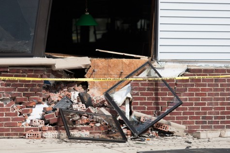 The side of Marty's next to Grant Avenue after an SUV crashed into the bar around 2:15 p.m. Thursday. The bar opened during the evening after gaining city approval. Bar manager Tyson Sledge said an estimate on damage is unknown.