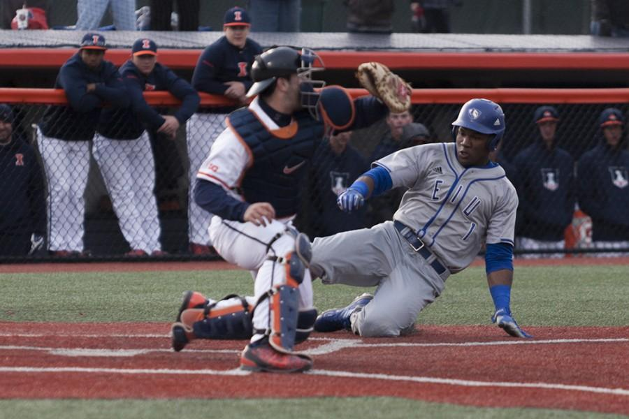 Senior outfielder Demetre Taylor slides into home during the Panthers 9-7 loss against Illinois on Tuesday at Illinois Field in Champaign. Taylor had two runs, two hits and two RBIs in the game.