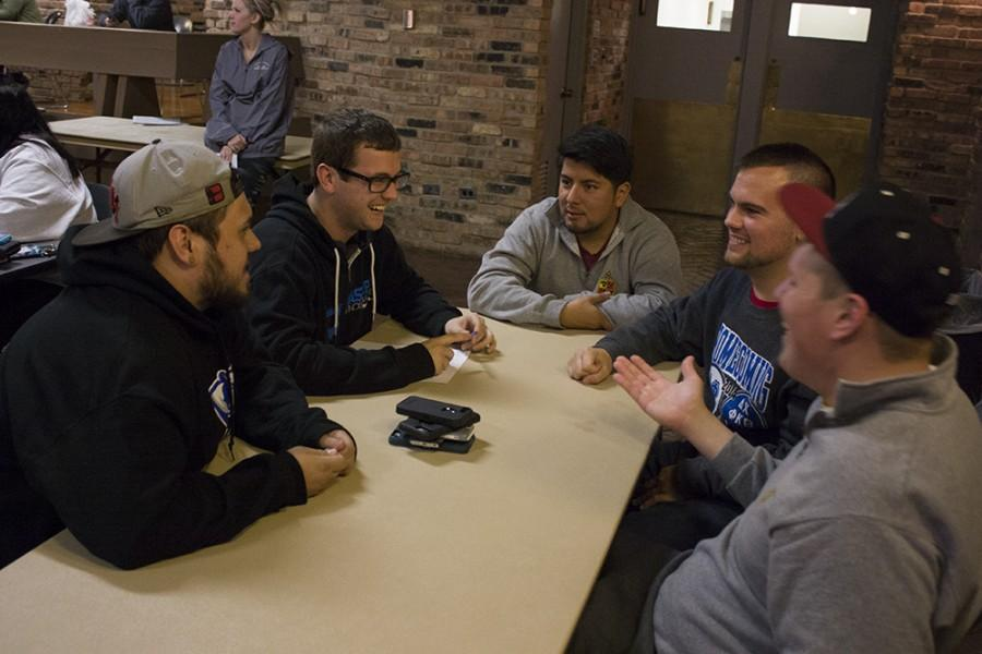 Members of Delta Chi Fraternity discuss answers to one of the questions Tuesday during  Greek Week Trivia Night at 7th Street Underground in the Martin Luther King Jr University Union.