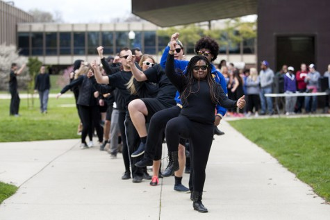 Greeks goin' up on a Thursday while dancing during the Greek Week Unity Stroll event in front of Doudna Steps.