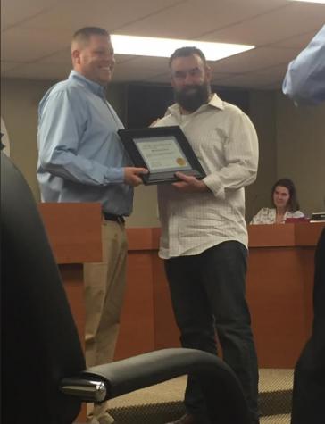 Charleston Mayor Brandon Combs gives Brendan Lynch the first Mayor Citizenship Award at the city council meeting Tuesday in Charleston City Hall.