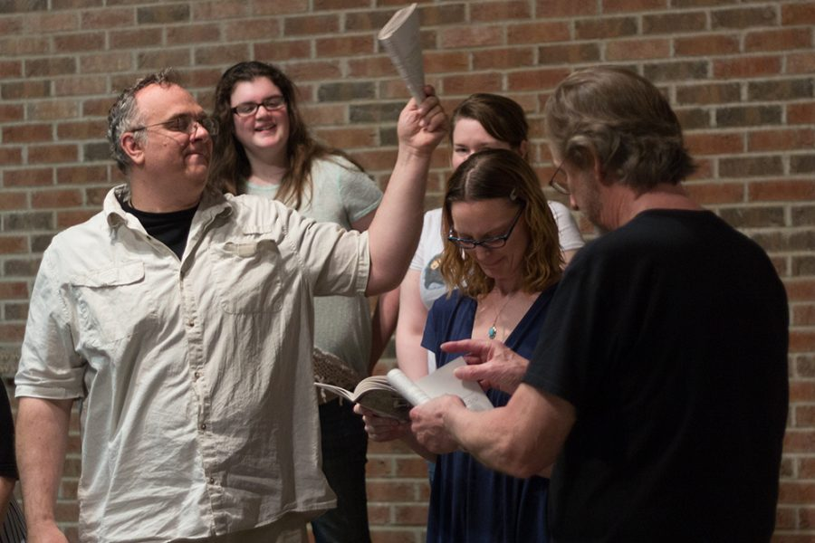 D. Craig Banyai, playing Leonato, hits the head of Marie Jozwiak, playing Hero, during the Charleston Alley Theatre's rehearsal of Shakespeare's Much Ado About Nothing on Monday. Duke Bagger, the president and executive director of the theatre, describes the play as,
