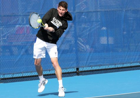 Senior Rui Silva returns the ball during his match against Belmont's Zak Khan on Saturday, April 1 at the Darling Courts. Silva lost to Khan 2-6, 6-3, 6-3.