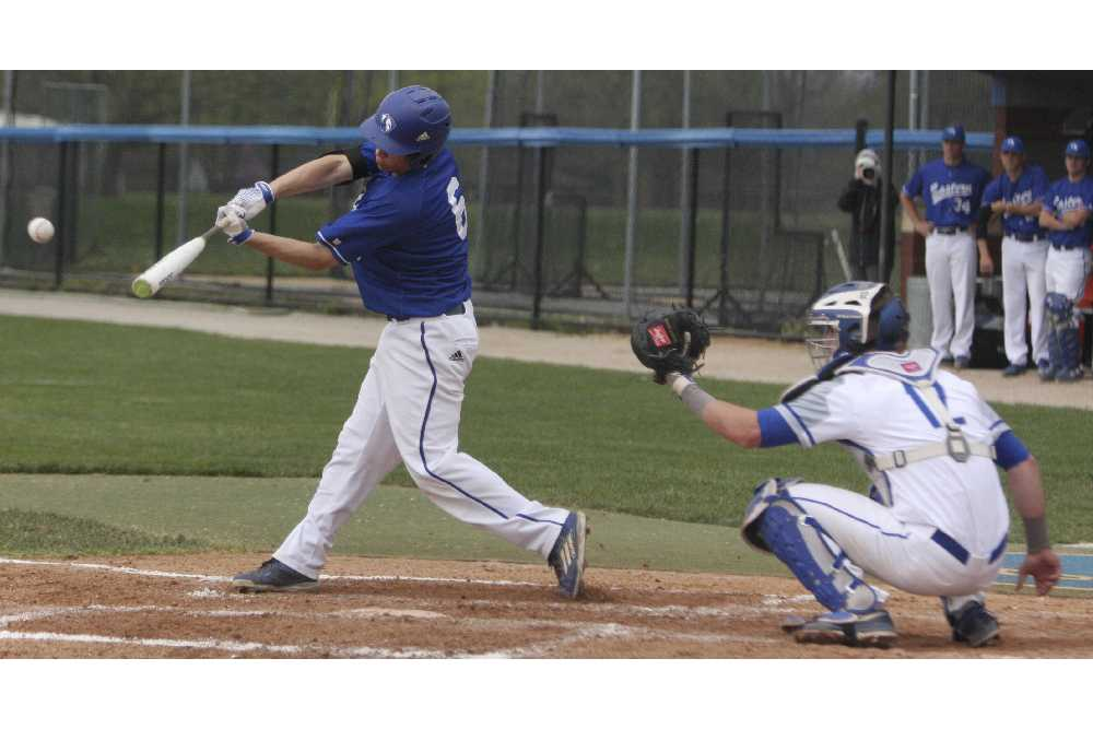 Cale Hennemann hits a double to left center to lead off the third inning Wednesday against Illinois College at Coaches Stadium. Hennemann hit a walk-off single in the 10th inning to win.