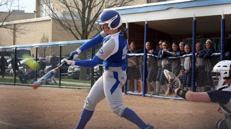 Senior Kylie Bennett hits the ball to center field March 22. at Williams Field against Butler. Bennett leads the team with 17 RBIs.