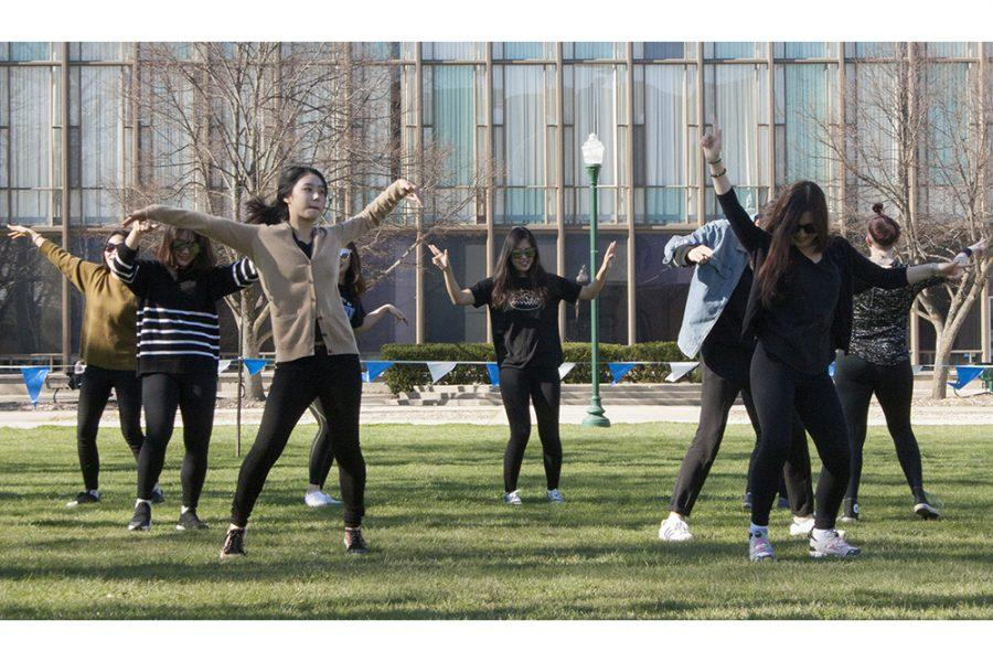 Students celebrate Asian heritage month with a K-Pop flash mob in the library quad Thursday.