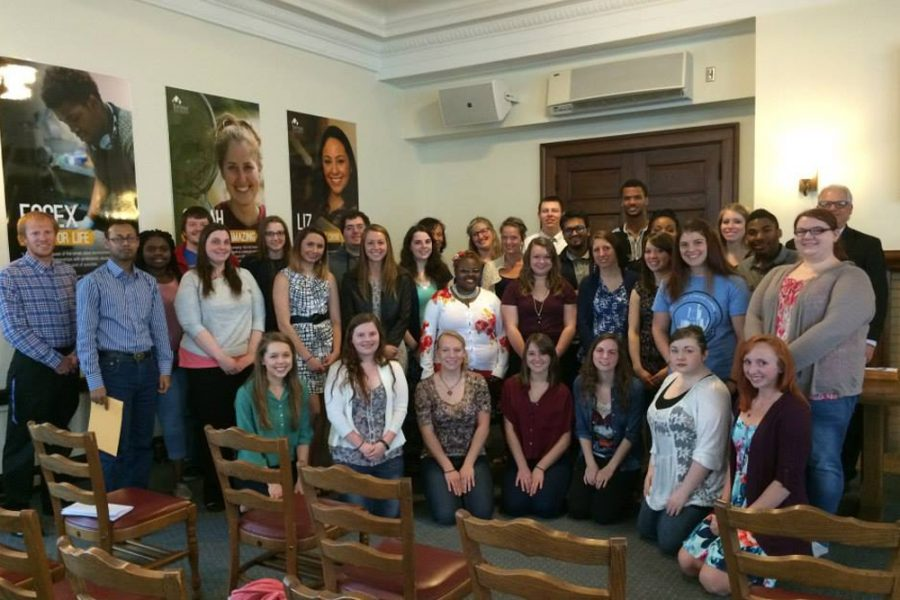 A group of students pose for a photo at the 2015 English Scholarship and Awards Tea in Pemberton Hall.