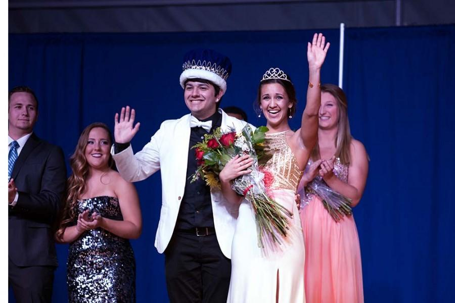 Alpha Phi sorority member Talia Perscio gets crowned by Mackenzie Boub, last years Greek Week Queen. Perscio and  Sigma Phi Epsilon fraternity member Daniel Guerrero were crowned the 2016 Greek Week royalty at the Airband competition Saturday in Lantz Arena.