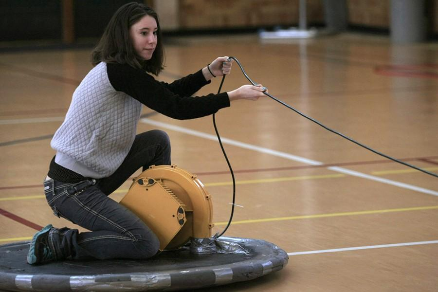 Sarah Banister, a senior chemistry major, glides across McAfee Gym on a hoverboard Saturday afternoon.