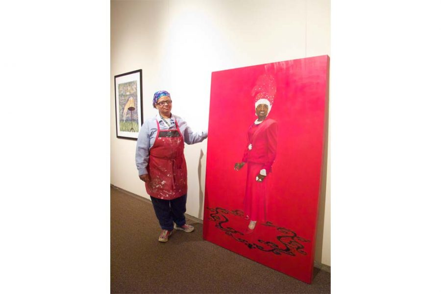Jacqueline D. Wright, graduate studio art graduate student, places her largest artistic work in the center of her display in hopes of catching the viewers attention.