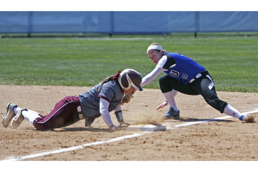 Freshman+Mady+Poulter+attempts+to+tag+an+Eastern+Kentucky+runner+out+at+first+base+during+the+Panthers%27+game+on+Saturday+at+Williams+Field.+The+Panthers+won+the+game%2C+1-0.