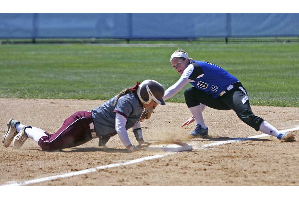 Freshman Mady Poulter attempts to tag an Eastern Kentucky runner out at first base during the Panthers' game on Saturday at Williams Field. The Panthers won the game, 1-0.