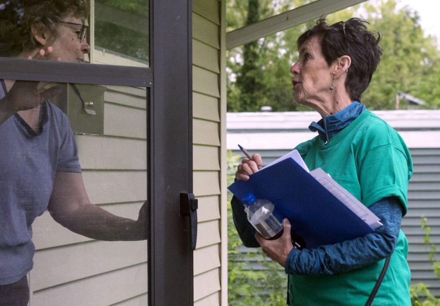 Deborah Lynch, an associate professor at Chicago State University, canvasses after the demonstration and march on May 16. Lynch and her peers visited the houses of registered voters in the area to ask them to sign a petition and/or put a sign in their yard.