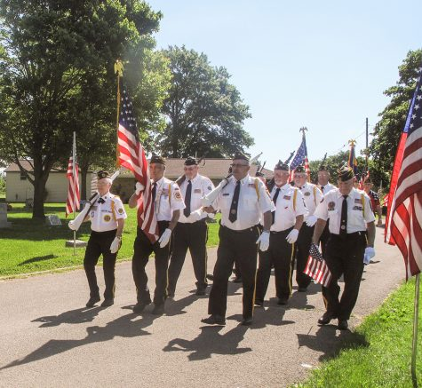 Members of the VFW and American Legion march in Roselawn Cemetery in honor of fallen veterans.