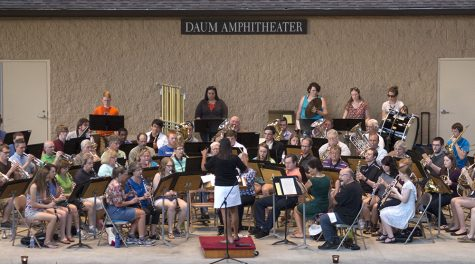 "The Charleston Community band plays the theme from ""Jack,"" which is an old TV show, Thursday during their opening concert at Kiwanis Park. The band will continue to hold concerts at 7:30 for the next five Thursdays."
