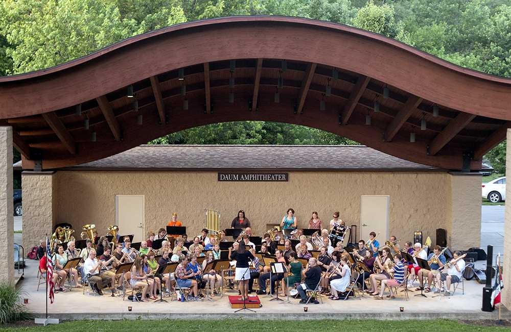 "The Charleston Community Band plays ""Dancing Queen"" by Abba Thursday in Kiwanis Park. This group consisted of 71 local instrumentalists with ages ranging from 13 to 90."
