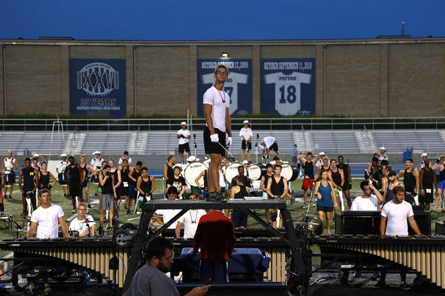 The Cavaliers Drum and Bugle Corp performed for Charleston and had their last practice at O'Brien field Saturday night. They have been at Charleston practicing for the last week and a half. They have been rehearsing in temperatures reaching 90 degrees for eight hours a day.