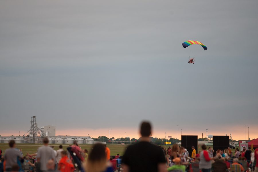 A paraglider flys around the crowd before the start of Monday's fireworks at the Coles County Memorial Airport.