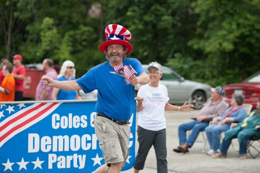 Duke Bagger, the president and executive director of The Charleston Alley Theatre dances during the parade on Monday.