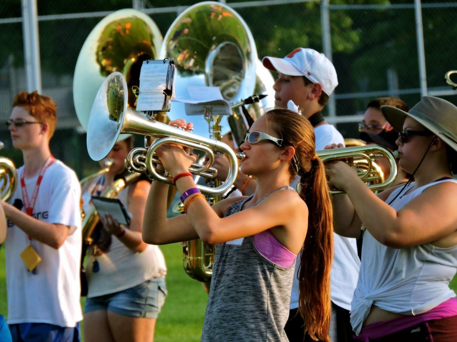 A young Mellophone player performs Jungle Love during a Smith Walbridge Clinic marching band practice Thursday at Tarble Field. Throughout the week, about 150 high school students from across the country honed their technical and performance skill during various marching classes on Easterns campus.