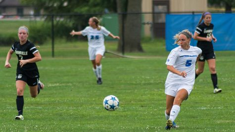 Justin Brown | The Daily Eastern News Ali Carlson, a junior midfielder, passes the ball during an exibition game against Evensville Sunday Aug. 14.