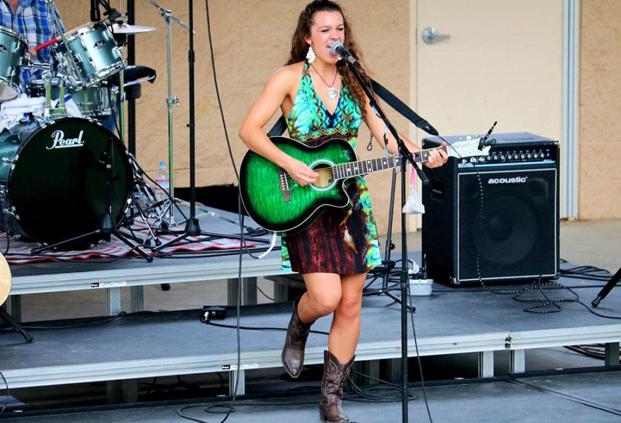 Kasey+Burton%2C+a+17-year-old+from+Carpentersville+Indiana%2C+sings+and+plays+guitar+at+Kiwanis+Park+during+Willstock+Festival+Saturday.