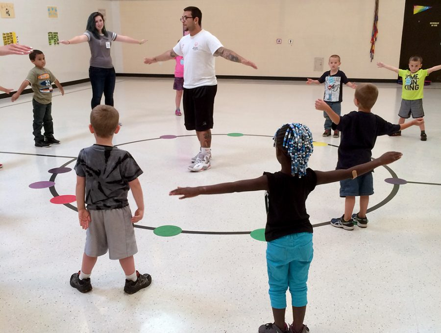 Eastern students volunteer for the Young Athletes program teach hand-eye coordination at Mark Twain Elementary School. This program is a stepping stone for the Special Olympics.