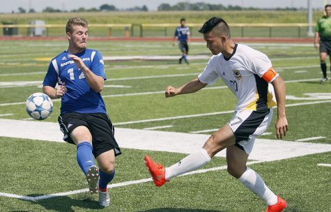 Sophomore midfielder Brendan McDonough attempts to block a pass during Sunday's 1-2 loss to Milwaukee at Judah Christian High School in Champaign.