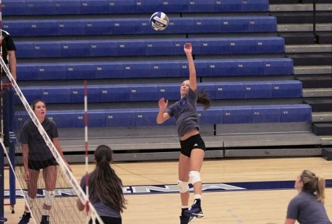 Junior rightside hitter Hayley Richardson spikes the ball during the Blue/Grey scrimmage Aug. 21 at Lantz Arena.