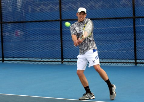 Junior Trent Reiman returns the ball during his singles match against Belmont's Toby Nicholson on Friday, April 1, 2016, at the Darling Courts. Reiman defeated Nicholson, 6-2, 7-5.