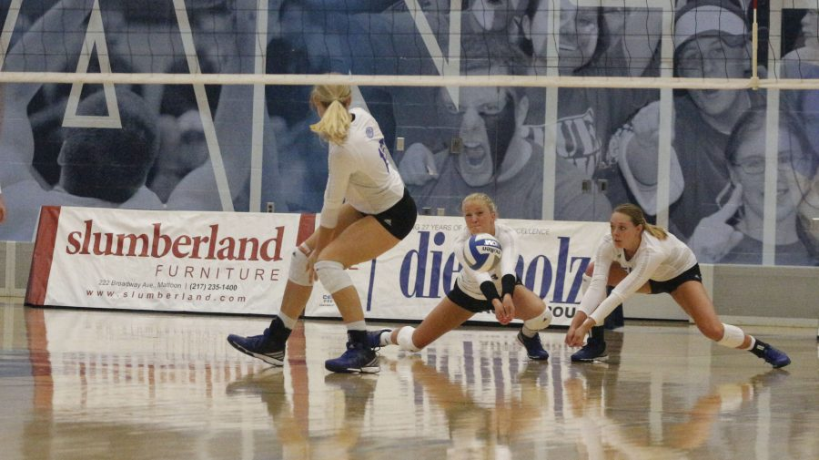 Lindsey Powers returns a serve while teammate Josie Winner backs her up in a 3-2 loss to Butler on Tuesday at Lantz Arena.