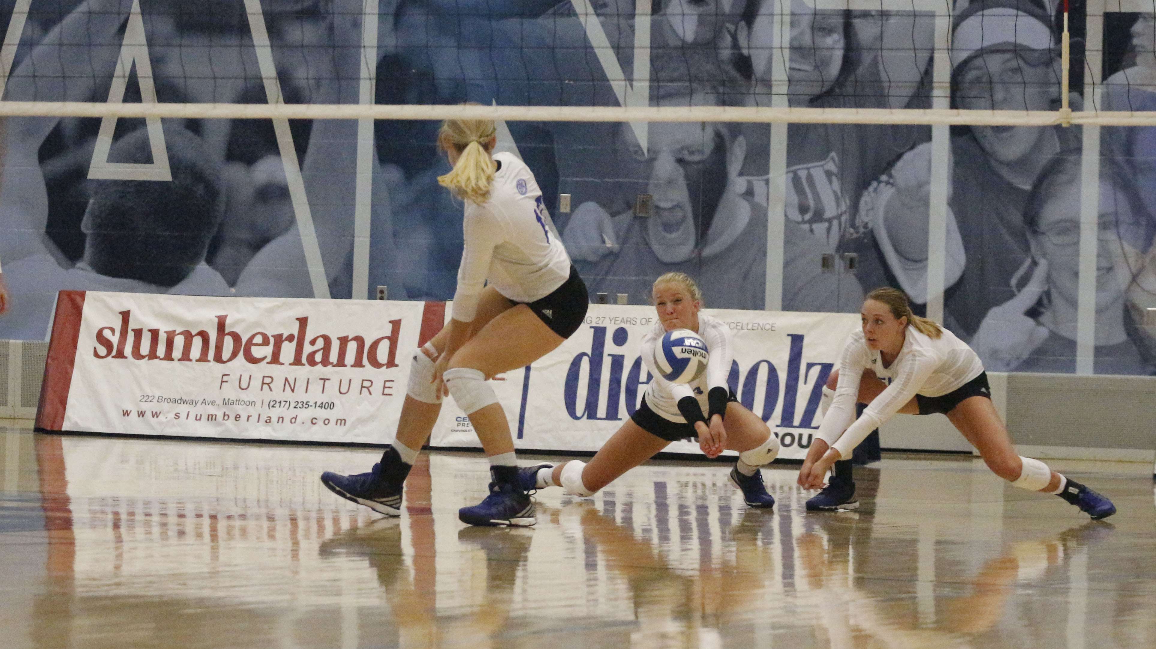 Lindsey Powers returns a serve while teammate Josie Winner backs her up in a 3-2 loss to Butler on Tuesday in Lantz Arena.