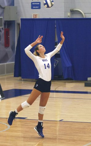 Redshirt Freshman Gina Fuller serves the ball during a match against Bulter on Tuesday. Eastern lost the match 3-2.