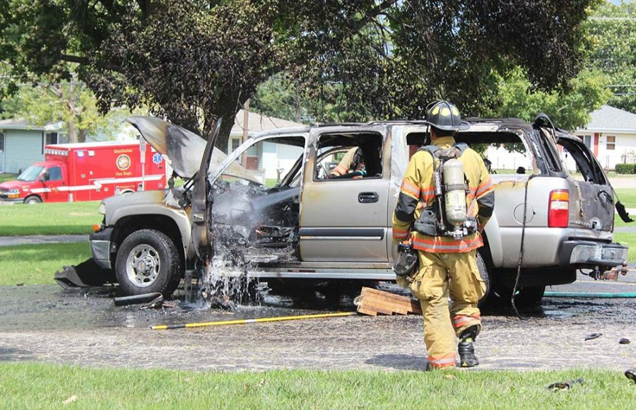 Charleston firefighters extinguish a car fire in the parking lot of Charleston Community Unit District 1 central office Friday afternoon.