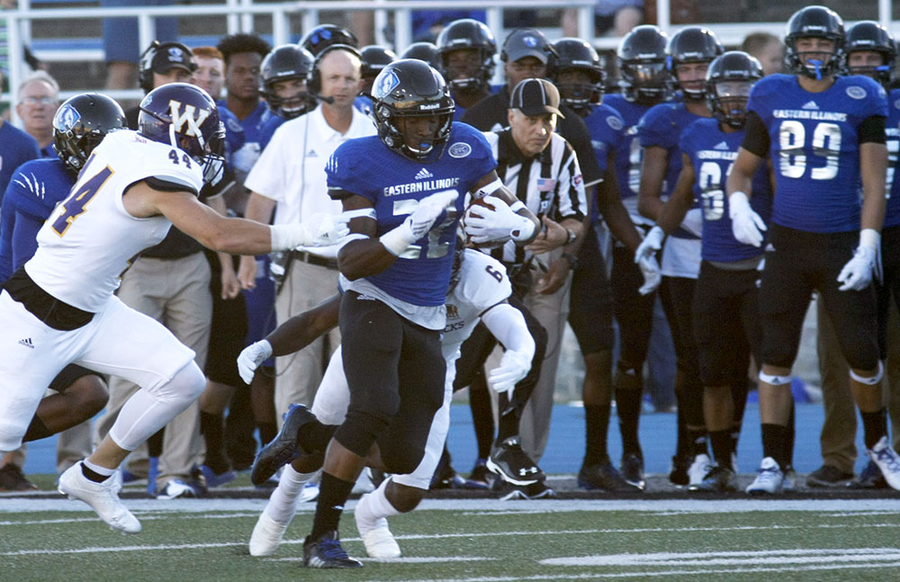 Eastern runningback Korliss Marshall breaks away from Western defenders in the first half Thursday at O'Brien Field. The Panthers lost 38-21.