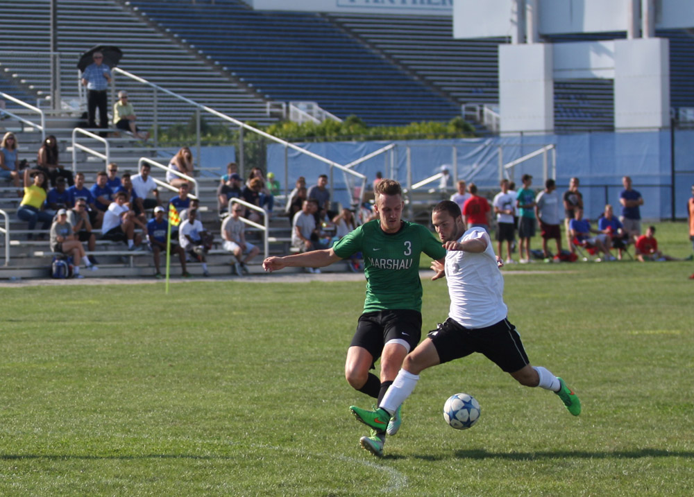Sophomore Forward Trevor Kerns advances the ball in a match against Marshall on Sunday. Panthers lost 1-0, finished with one shot on goal.