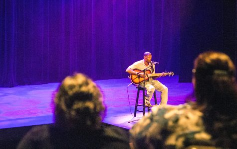 "Olivia Swenson-Hultz | The Daily Eastern News Sedd the Light plays and sings his original song ""Cool Breeze"" during the filming of Song Stage Midwest in the Doudna Theater of the Doudna Fine Arts Center Friday."