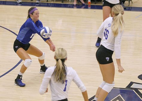 Junior rightside hitter Hayley Richardson returns a serve while teammates Maggie Runge (16) and Taylor Smith (7) watch on in a match Tuesday against Bulter. The Bulldogs beat Eastern 3-2.