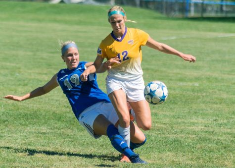 Sophomore Kate Olson kicks the ball away from a Northern Iowa player on Sunday. Olson scored a goal in the 49th minute on a header from Carrie Caplin. The Panthers won the match over Northern Iowa, 3-0.