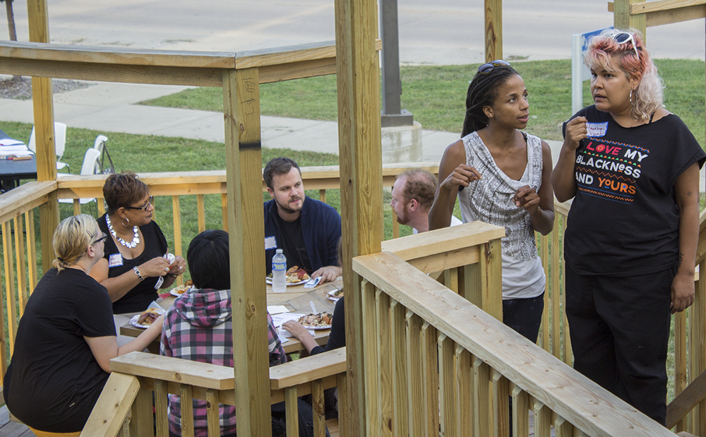 """Co-founders of """"Black Lunch Table"""" Jina Valentine and Heather Hart decide where to seat guests Tuesdday at the Tarble Arts Tables. """"Our goal is to encourage a space of discussion across demographics,"""" Hart said."""