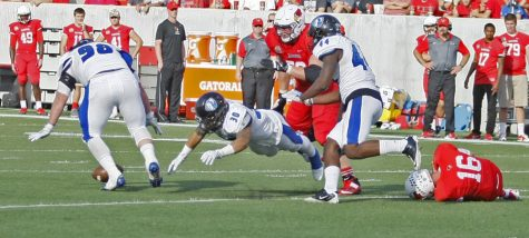 Tayler Arterburn (left) recovers a fumble foced by Nick Horne after a hit on ISU quarterback Jack Kolbe Saturday at Hancock Stadium.
